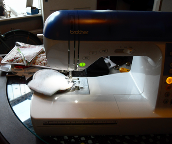 Sew the fabric onto the wadding